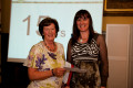 Sandra Rose, Office Manager in Central Oxford, receives an award for 15 years of service